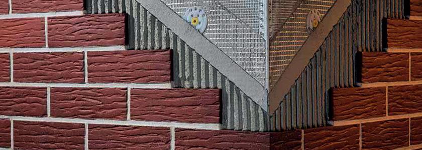 Отделка фасада каменного дома бетонной плиткой «под кирпич». Инструкция по монтажу